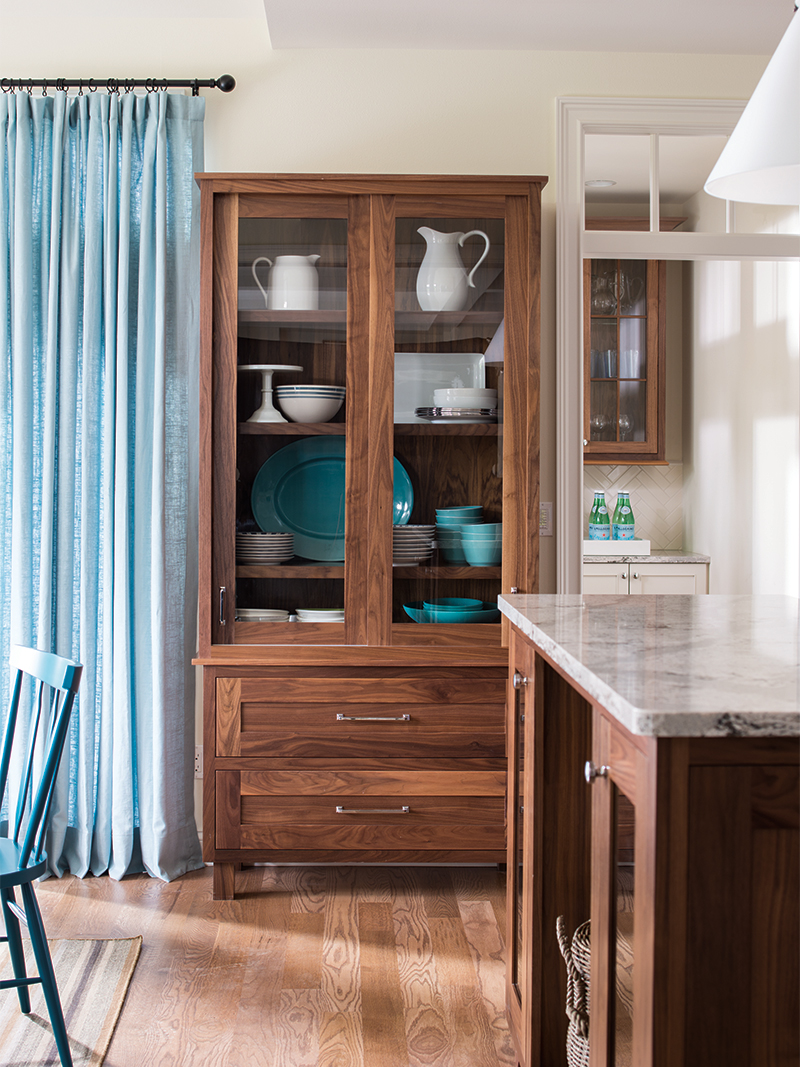 A Hutch with Glass Front Cabinet Doors
