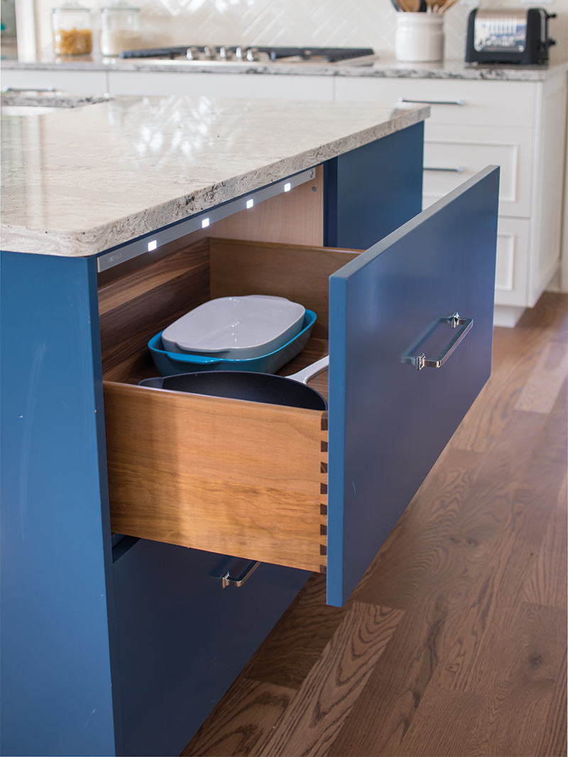 Blue Kitchen Cabinet with Open Drawer